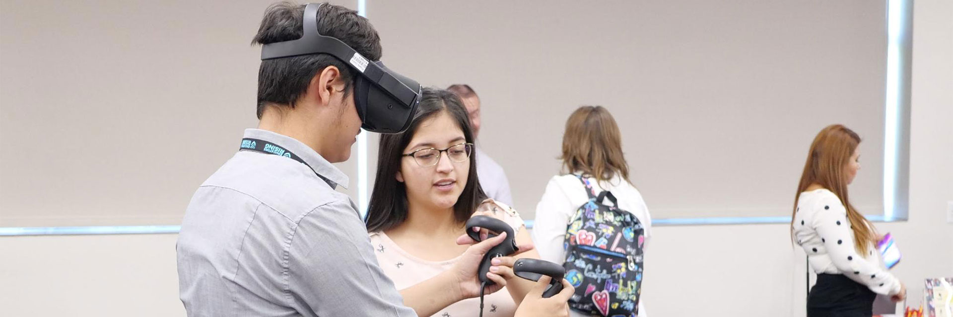 Visitors to the Ed Rising event try out a VR headset.