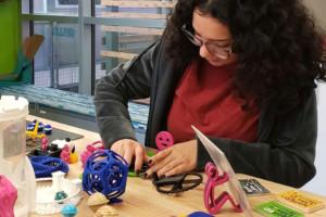 Sabrina testing a 3D print in the IgnitED lab.