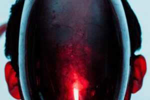 A humanoid form with a glowing red glass face